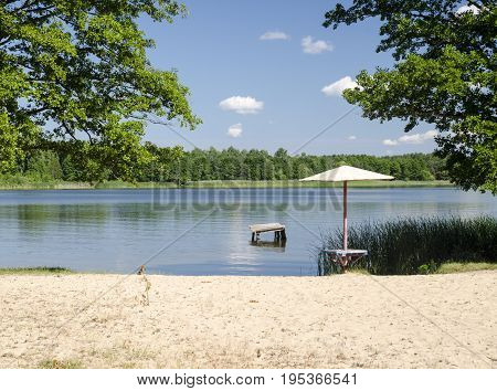 Summer beach background. Little beach at the river summer vacation conceptual photo