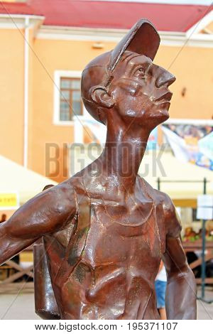 KAMIANETS-PODIILSKYI, UKRAINE - MAY 20, 2017: Iron sculpture of Tourist is located in the central square of Kamianets-Podilskyi, Ukraine