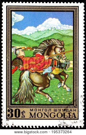UKRAINE - CIRCA 2017: A postage stamp printed in Mongolia shows Lancer on horseback from the series Paintings by contemporary artists in Ulan Bator Museum circa 1972