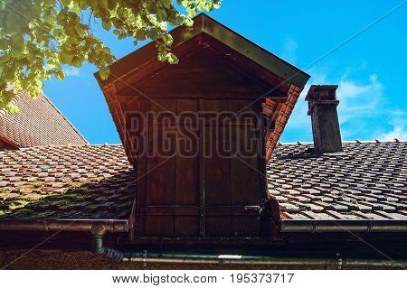 Old Wooden Window In Upper Storey Of Village House