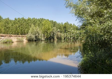 Views of the River Esla on its way through Villanueva de las Manzanas Municipality, in Leon Province, Spain