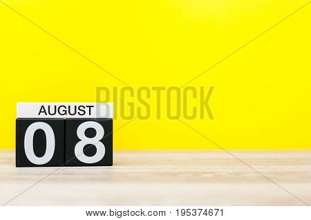 August 8th. Image of august 8, calendar on yellow background with empty space for text. Summer time.