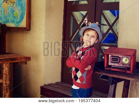 stylish boy with a retro radio in the street