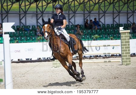 Turda, Cluj, Romania - 1th July, 2017: An unidentified competitor jumps with his horse at the Salina Equines Horse Trophy , 1th July, 2017 in Turda, Romania