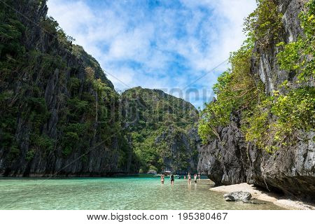 EL NIDO PALAWAN PHILIPPINES - JANUARY 17 2017: Sharp rocks trees and blue lagoon of El Nido.