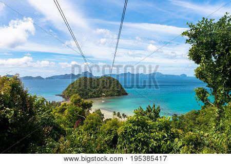 EL NIDO PALAWAN PHILIPPINES - JANUARY 18 2017: The amazing zipline of Las Cabanas Beach with a great view of the bay rocks and trees.