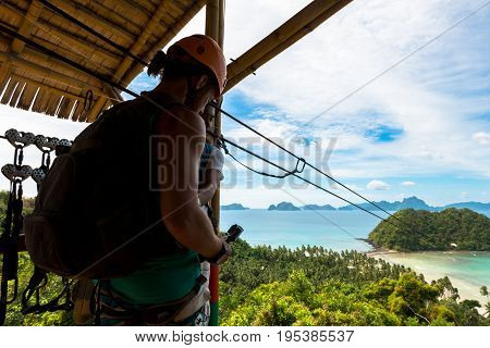 EL NIDO PALAWAN PHILIPPINES - JANUARY 18 2017: Wide angle view of tourist waiting to get the zipline to go to Las Cabanas Beach.
