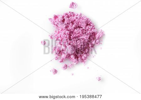Crushed pink eye shadow isolated on the white background