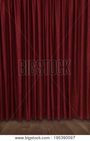 Dark red closed sumptuous velvet theater curtain