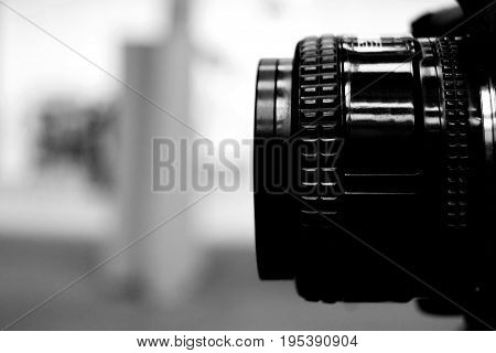 Camera lens in black and white historical