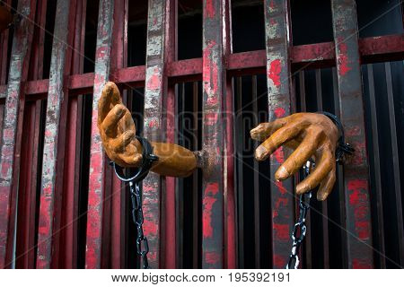 Human Hand Of Ghost Prisoner On Steel Lattice Close Up For Halloween Background. Criminal Hand Show