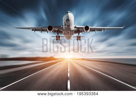 Airplane And Road With Motion Blur Effect At Sunset.