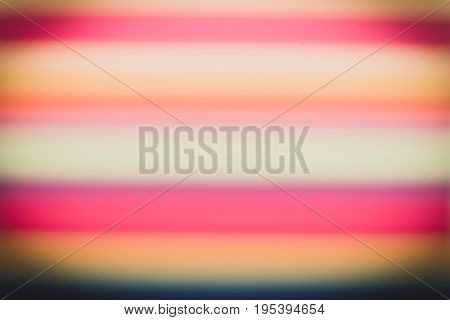 Abstract background from many multi-color straws making striped.