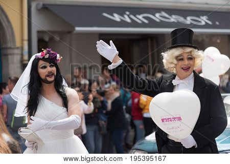 MUNICH GERMANY - 15 JULY 2017: A couple dressing as bride and groom in the pride parade on the Christopher Street Day Translation: Finally marriage for all