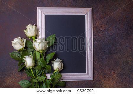 Black chalk board on a brown background copyspace horizontal