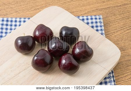 Fresh Fruits Stack of Ripe and Sweet Red Plums A Very Good Source of Vitamin C on A Wooden Cutting Board.