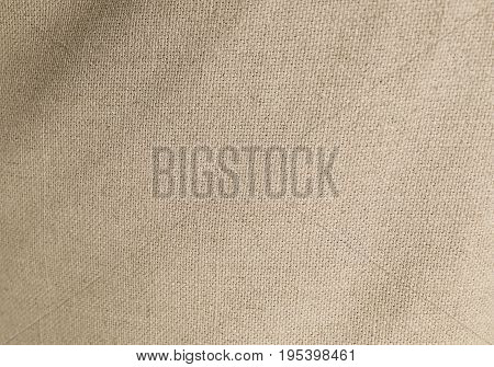 Textile Texture Close Up of Light Brown Sack or Burlap Fabric Pattern Background with Copy Space for Text Decoration.