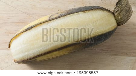 Fruits An Open Ripe Banana Asian Banana or Cultivated Banana on A Wooden Table.