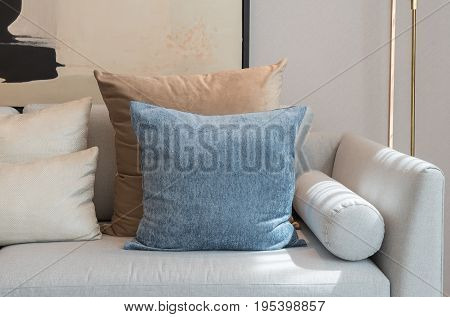 Modern Living Room With Set Of Pillows On Sofa