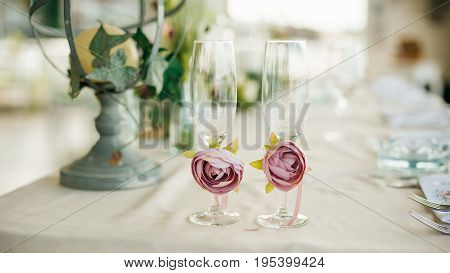 Glasses For Newlyweds Bride Decorated With Roses Stand On Table