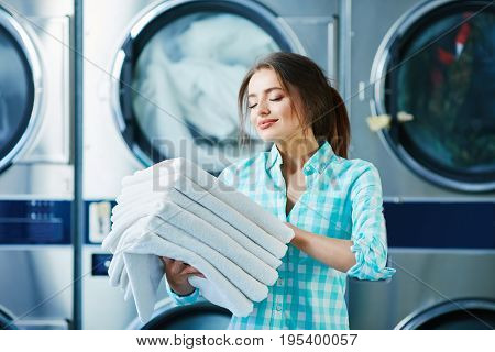 Girl With Fresh Soft  Linen Near Washing Machines