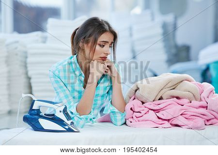 Girl Leaning On Ironing Board