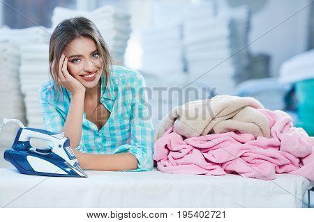 Beautiful Woman Leaning On Ironing Board