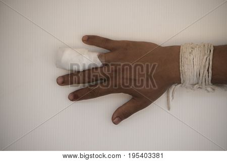 Wound at finger with bandage on white background