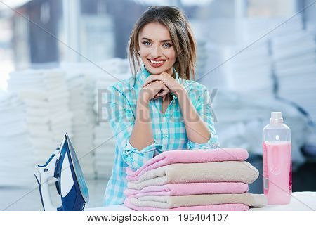 Girl Leaning On Heap Of Rose Towels