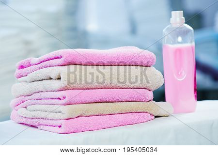 Rose Detergent And Heap Of Rose And Beige Towels