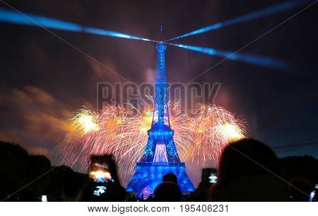 PARIS, FRANCE - JULY 14, 2017: Famous Eiffel Tower and beautiful fireworks during celebrations of French national holiday - Bastille Day.