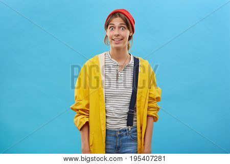 Surprised Woman Wearing Casual Clothes Posing Against Blue Background Looking With Bugged Eyes Wonde