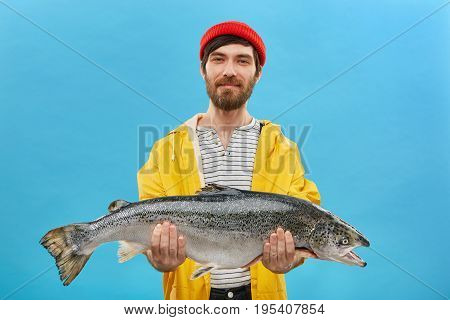 Proud Bearded Fisherman Having Glad Expression Catching Big Fish Having Successful Day. Handsome Mal
