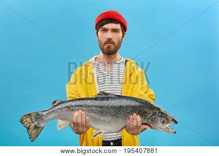 Young Unshaven Fisherman Spending Many Days On Lake Cathcing Fish Holding His Big Catch In Hands Loo