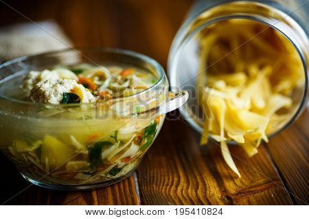 Soup With Homemade Noodles And Meatballs