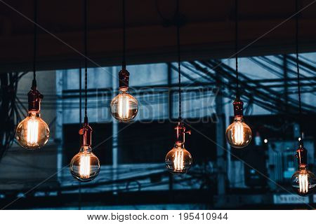Decoration antique edison led light style filament light bulbs graphic of wire background and copyspace on topcolor vintage styleThailand