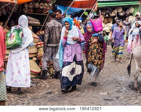 ADDIS ABEBA ETHIOPIA - JUNE 06 2016: People at Addis Mercato in Addis Abeba Ethiopia the largest market in Africa.