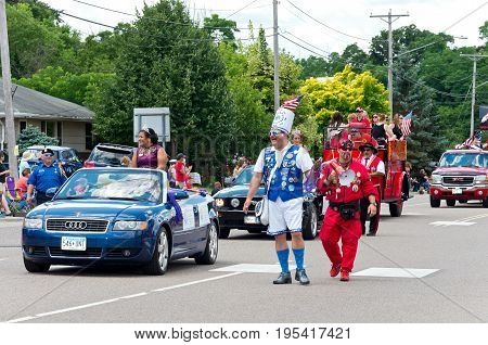 MENDOTA, MN/USA - JULY 8, 2017: Royal Court of the Saint Paul Winter Carnival entertain crowd during annual Mendota Day Parade.  Mendota is one of the first permanent settlements in Minnesota.