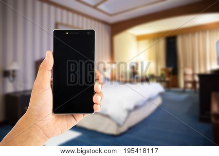 hand use smartphone online booking luxury hotel room