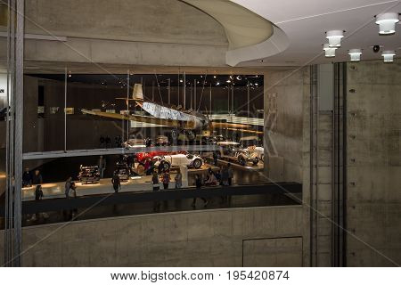 STUTTGART GERMANY- MARCH 19 2016: The interior of the museum in the background Klemm-Daimler L20 lightweight aircraft 1928. Mercedes-Benz Museum.
