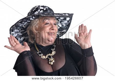 Senior woman in blouse shruging the hand on white background