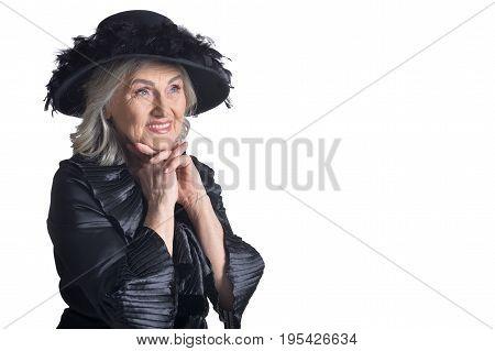 Senior woman in blouse smiling on white background