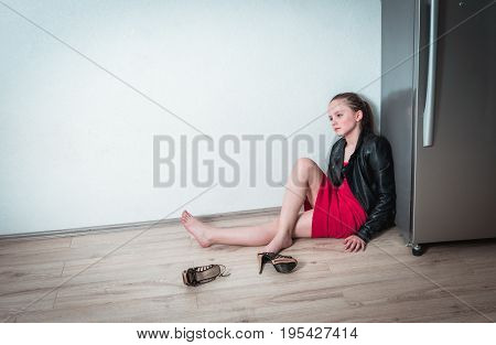 Girl in depression sitting alone at home