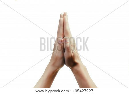 Two old palm are clasped all together over whte background. Praying woman woth her hand clasped.