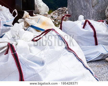 Some large bags containing processing waste montain