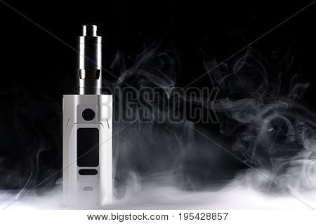 Electronic Cigarette Over A Dark Background.