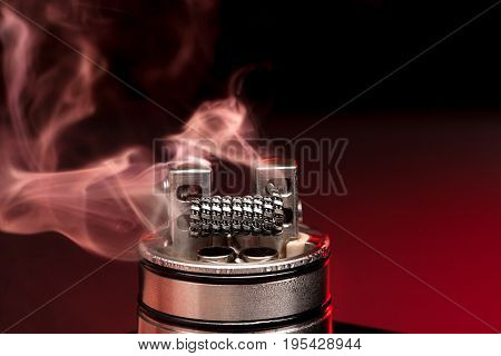 Applying Liquid With Nicotine In The Coils On The Rda