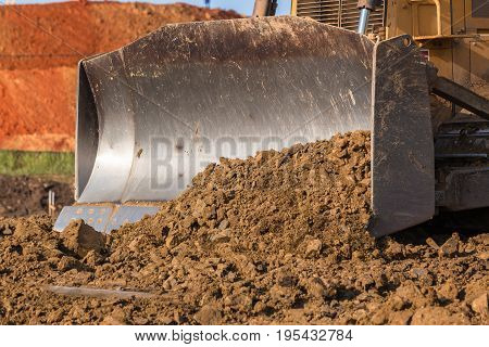 Construction industrial earthworks earth mover dozer bucket closeup sand stones  abstract.
