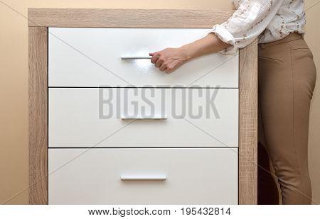 Woman Pulling Drawer