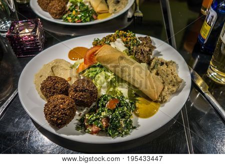 Typical falafel arabic dish topped with salad and sauces